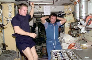 Astronaut Bill Shepherd, left, and cosmonaut Yuri Gidzenko in photo taken by cosmonaut Sergei Krikalev inside the International Space Station.