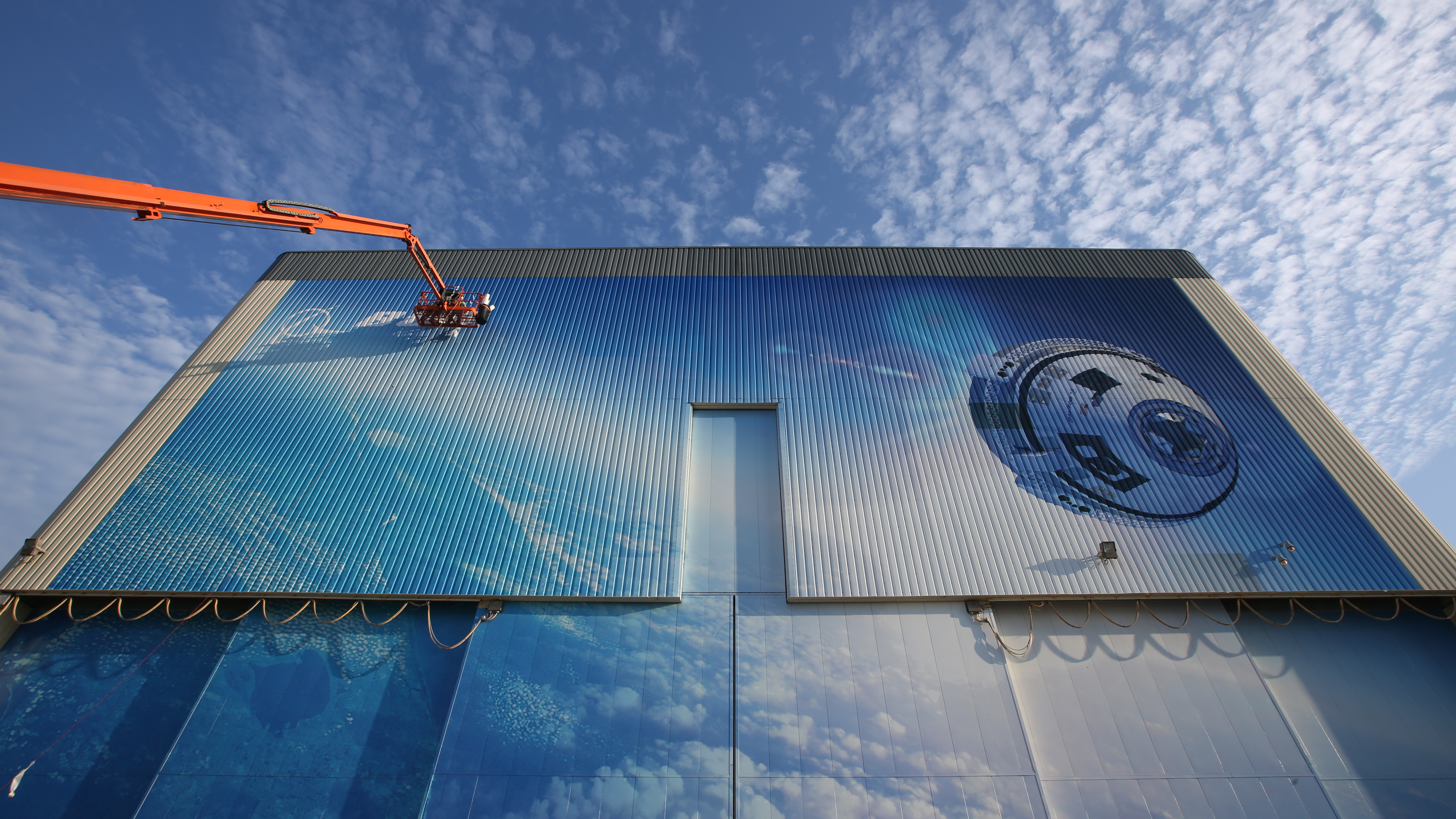 Boeing wraps up c3pf mural work commercial crew program for Construction mural