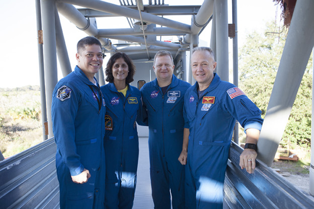 Astronauts Celebrate With Builders Topping of Crew Access Tower