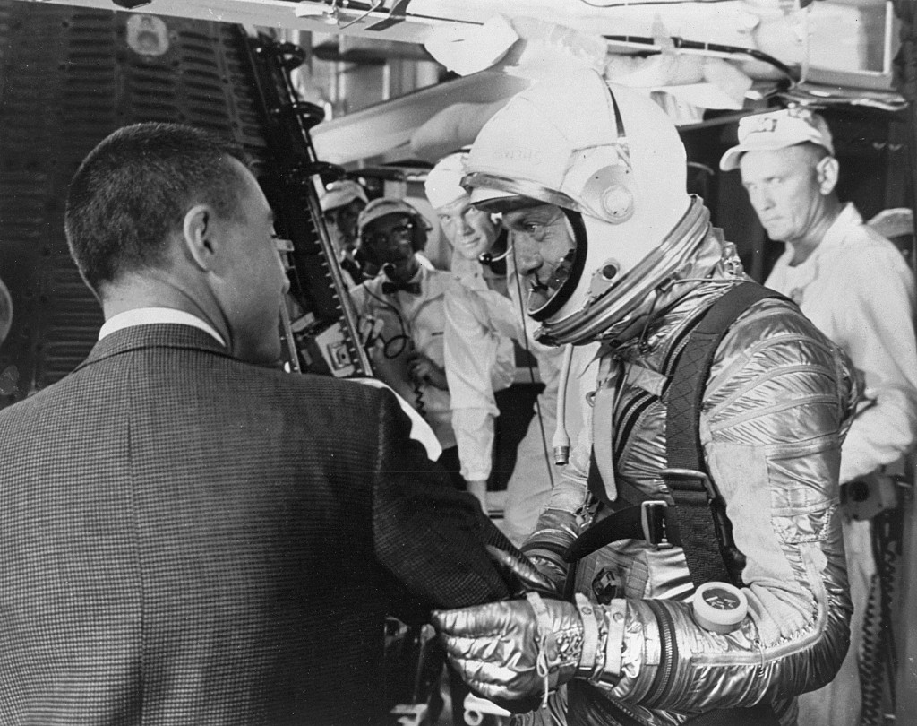 "Astronaut Virgil I. ""Gus"" Grissom wishes Alan B. Shepard a safe flight just before insertion into the Freedom 7 spacecraft mated on the Redstone rocket."