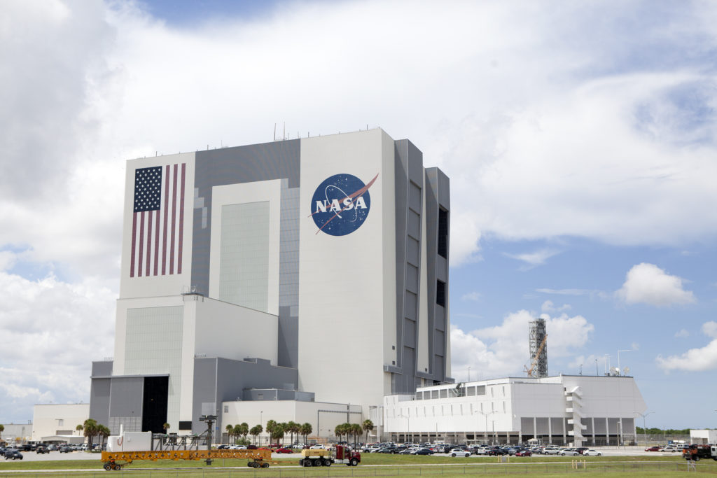 Crew Access Arm passes by the VAB at Kennedy Space Center, in route to Pad 41, to be installed for the Commerical Crew Program (CCP) upcoming missions.