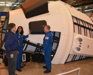 CCP Astronauts, Eric Boe and Suni Williams, near the Boeing Mission Simulator located in St Louis Missouri.