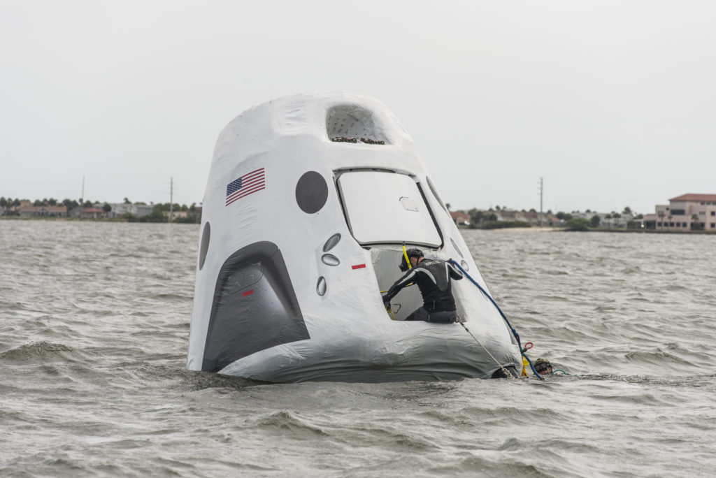 SpaceX's Recovery Trainer was lowered into the Indian River Lagoon near NASA's Kennedy Space Center so Air Force pararescue and others could learn techniques for getting aboard the spacecraft and rescuing the astronauts.
