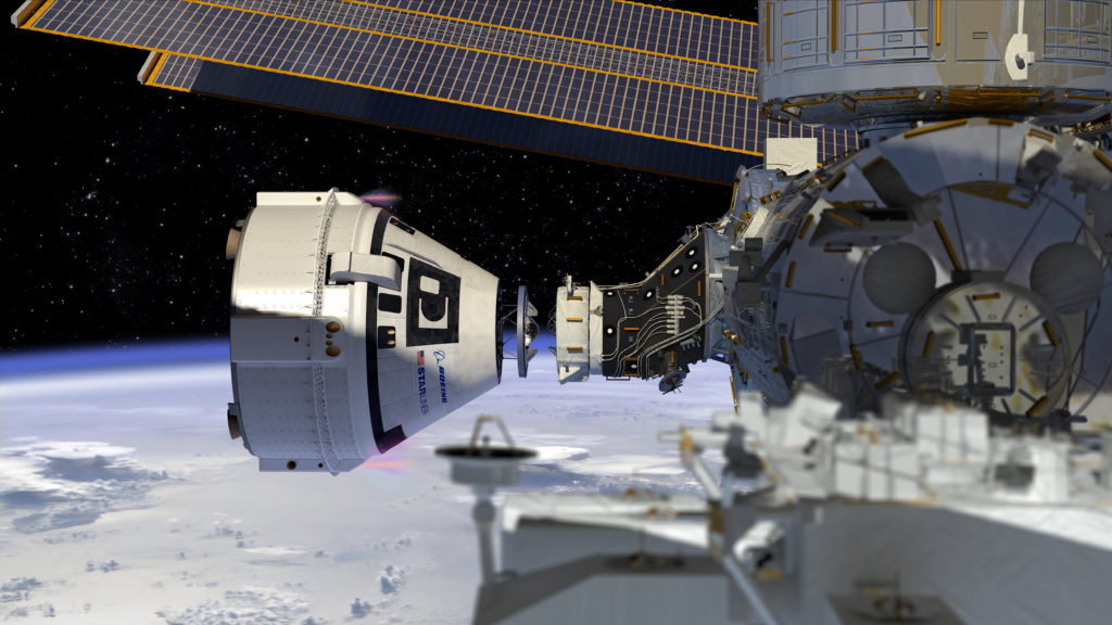 An artist image of the Boeing Starliner spacecraft docking to the International Space Station.