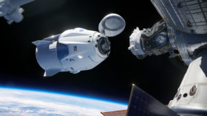 This illustration shows the SpaceX Crew Dragon spacecraft docking to the International Space Station.