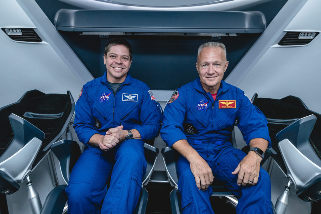 NASA astronauts, from left, Bob Behnken and Doug Hurley, assigned to fly on SpaceX's Demo-2 test flight of its Crew Dragon, are inside a mockup of the spacecraft at NASA's Johnson Space Center in Houston on Aug. 2, 2018