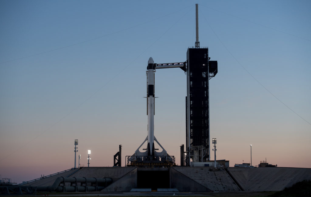A SpaceX Falcon 9 rocket with the company's Crew Dragon spacecraft onboard is seen after being raised into a vertical position on the launch pad at Launch Complex 39A as preparations continue for the Demo-1 mission, Feb. 28, 2019, at NASA's Kennedy Space Center in Florida.