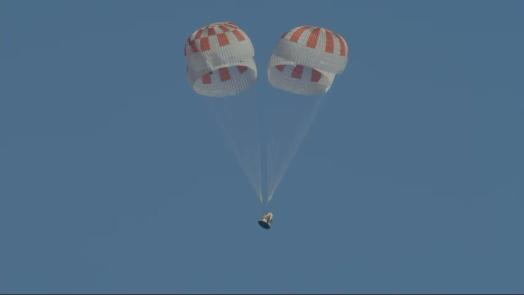 The SpaceX Crew Dragon descends under its four main parachutes toward a splashdown in the Atlantic Ocean at 8:45 a.m. EST, Friday, March 8, 2019.