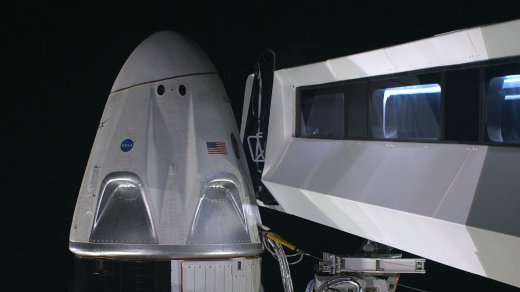 At NASA Kennedy Space Center's Launch Complex 39A, the crew access arm has been extended to the SpaceX Crew Dragon spacecraft, attached atop the company's Falcon 9 rocket.