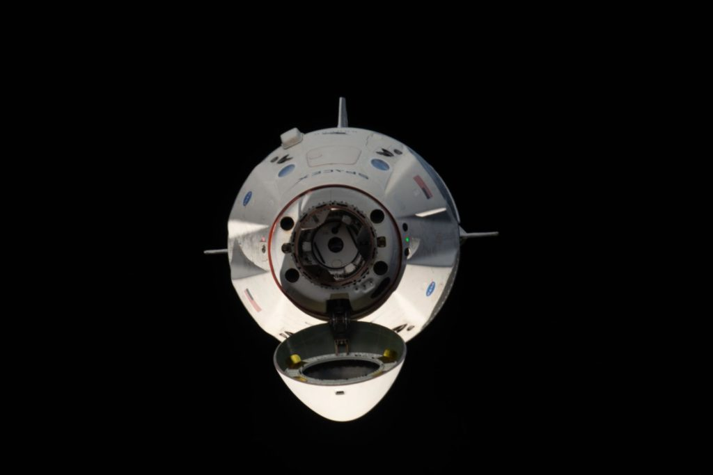 The uncrewed SpaceX Crew Dragon spacecraft s pictured with its nose cone open revealing its docking mechanism while approaching the International Space Station's Harmony module on March 3, 2019.