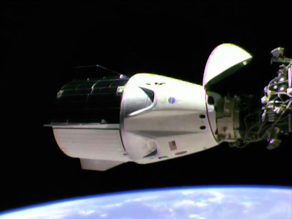 The SpaceX Crew Dragon is docked to the station's international docking adapter which is attached to the forward end of the Harmony module.
