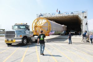 The United Launch Alliance (ULA) Atlas V booster that will be used for Boeing's Crew Flight Test (CFT) is moved out of the Mariner cargo ship at the Army Wharf at Cape Canaveral Air Force Station in Florida on June 5, 2019.