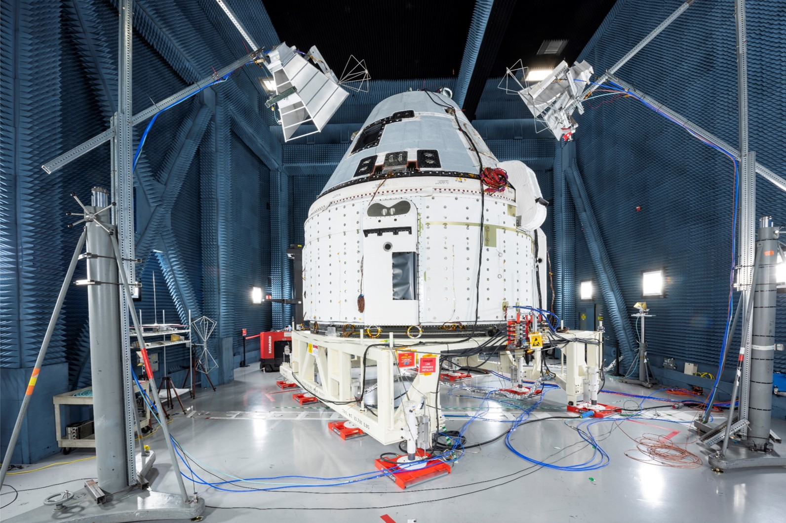 Boeing's CST-100 Starliner prepares for electromagnetic interference and electromagnetic contamination (EMI/EMC) testing in a specialized test chamber