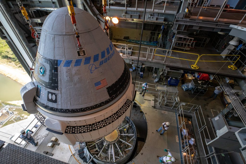 The Boeing CST-100 Starliner spacecraft is guided into position above a United Launch Alliance Atlas V rocket at the Vertical Integration Facility at Space Launch Complex 41 at Florida's Cape Canaveral Air Force Station on Nov. 21, 2019. Starliner was secured atop the rocket for Boeing's Orbital Flight Test to the International Space Station for NASA's Commercial Crew Program.