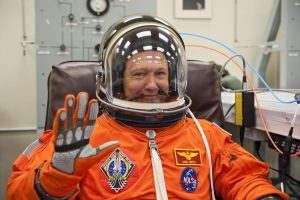 In this photo taken July 8, 2011, STS-135 pilot Douglas Hurley waves after putting on his launch-and-entry suit and helmet prior to liftoff on the final space shuttle mission.