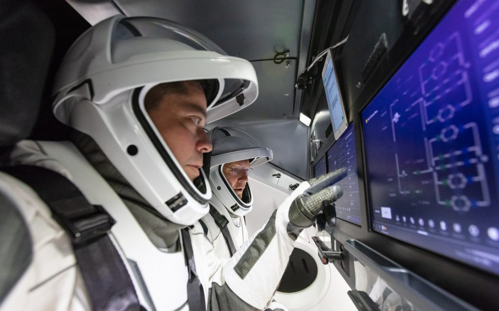 NASA astronauts Doug Hurley and Bob Behnken familiarize themselves with SpaceX's Crew Dragon, the spacecraft that will transport them to the International Space Station as part of NASA's Commercial Crew Program.