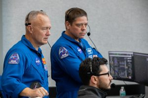 NASA astronauts Doug Hurley, left, and Bob Behnken watch the liftoff of a SpaceX Falcon 9 rocket and Crew Dragon spacecraft on the uncrewed In-Flight Abort Test, Jan. 19, 2020, inside Firing Room 4 in Kennedy Space Center's Launch Control Center.