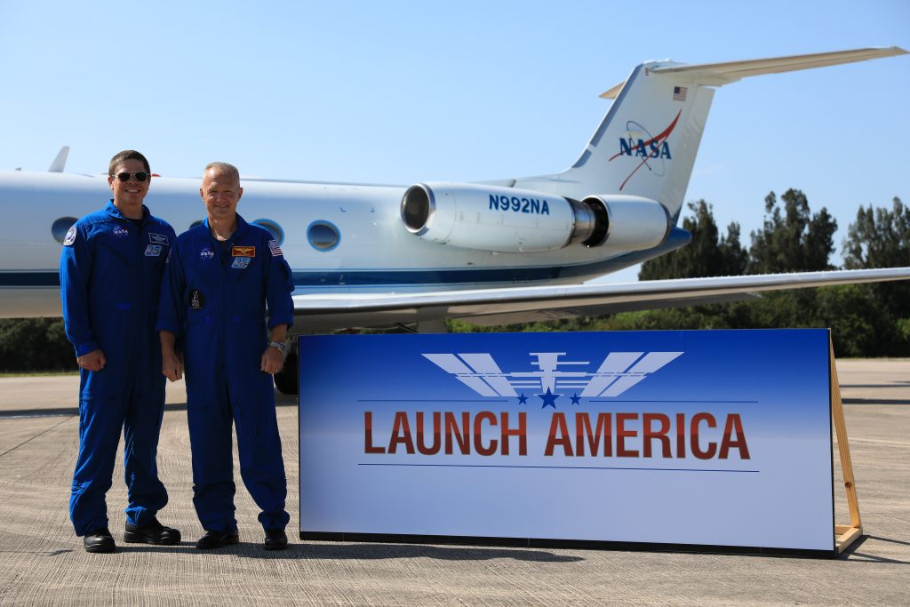 From left, Demo-2 crew members Robert Behnken and Douglas Hurley pose for a photo after speaking to members of the media on May 20, 2020, at the Launch and Landing Facility runway following the crew's arrival to the Florida spaceport.