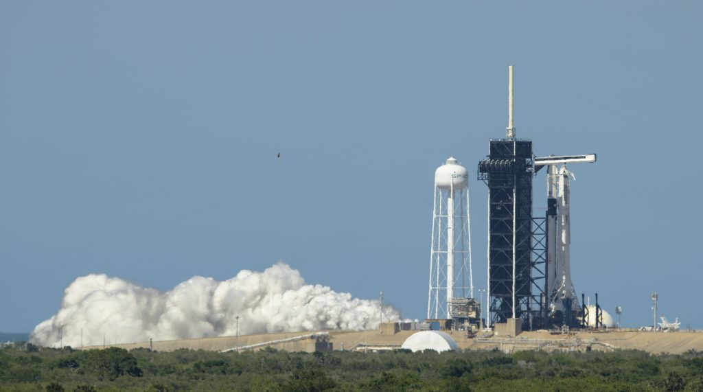 SpaceX conducted an integrated static fire test of the company's Crew Dragon spacecraft and Falcon 9 rocket at Launch Complex 39A at NASA's Kennedy Space Center in Florida on May 22, 2020.