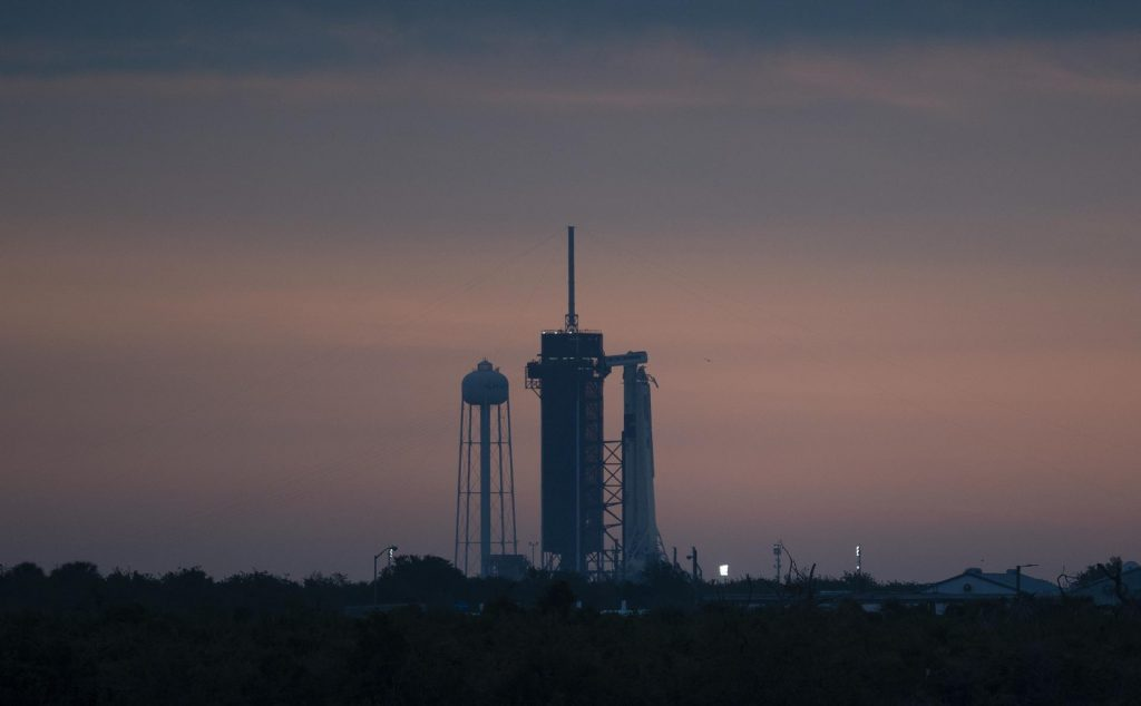 A SpaceX Falcon 9 rocket with the company's Crew Dragon spacecraft onboard is seen on the launch pad at Launch Complex 39A at sunrise as preparations continue for the Demo-2 mission, Wednesday, May 27, 2020, at NASA's Kennedy Space Center in Florida.