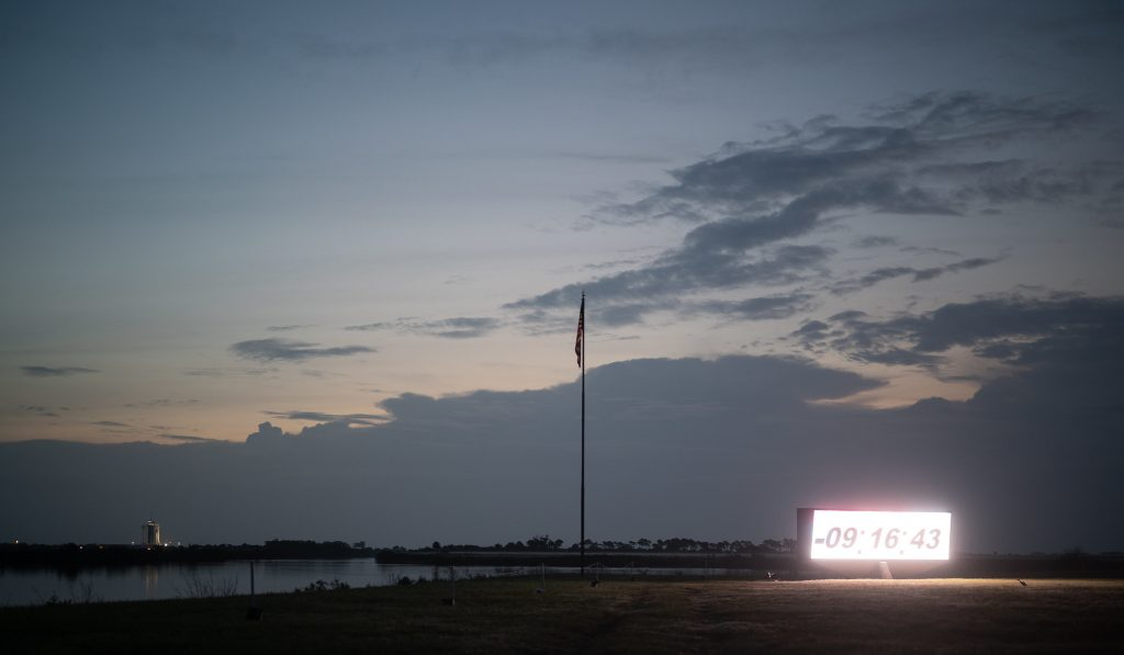 The countdown clock at NASA's Kennedy Space Center Press Site is seen during sunrise on launch day for NASA's SpaceX Demo-2 mission, Saturday, May 30, 2020, in Florida.