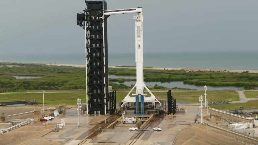 NASA's SpaceX Demo-2 crew arrives at the base of the SpaceX Falcon 9 rocket at Kennedy's Launch Complex 39A.