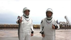 NASA astronauts Robert Behnken, left, and Douglas Hurley on Launch Complex 39A before boarding the SpaceX Crew Dragon atop the company's Falcon 9 rocket, May 27, 2020.
