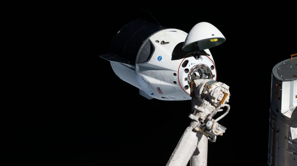 The uncrewed SpaceX Crew Dragon spacecraft became the first Commercial Crew vehicle to visit the International Space Station in March 2019 during NASA's SpaceX Demo-1 mission. Here it is pictured on March 3, 2019, with its nose cone open to reveal its docking mechanism while approaching the station's Harmony module.