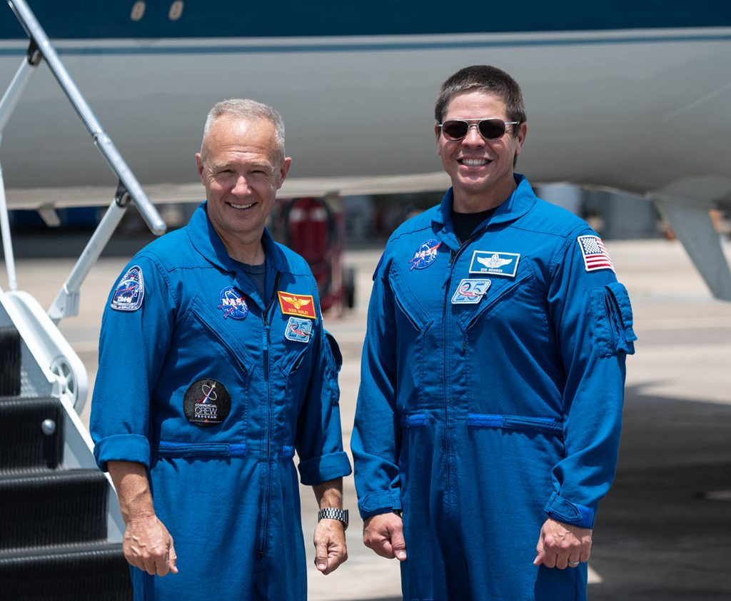 At Ellington Field near NASA's Johnson Space Center in Houston, astronauts Douglas Hurley (left) and Robert Behnken pose for a photo before boarding the Gulfstream jet that will carry them to the agency's Kennedy Space Center in Florida on May 20, 2020, in preparation for NASA's SpaceX Demo-2 mission. Photo credit: NASA/James Blair