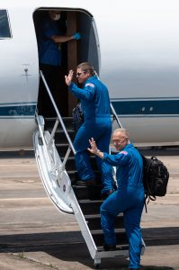 At Ellington Field near NASA's Johnson Space Center in Houston, astronauts Robert Behnken (left) and Douglas Hurley board the Gulfstream jet that will carry them to the agency's Kennedy Space Center in Florida on May 20, 2020, in preparation for NASA's SpaceX Demo-2 mission.