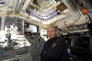 Astronaut Doug Hurley, STS-127 pilot, is pictured at space shuttle Endeavour's aft flight deck controls during flight day five operations with hardware on the International Space Station, July 19, 2009.