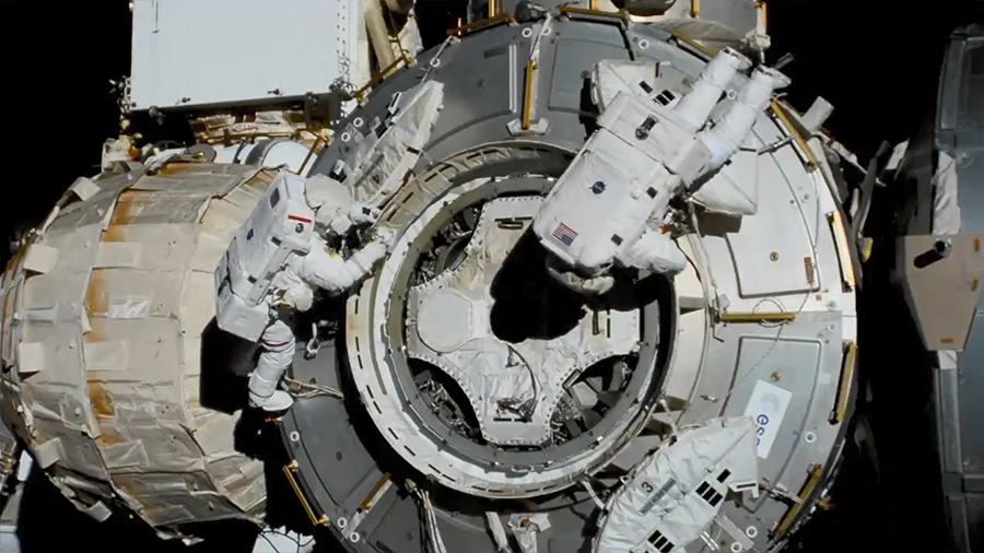 NASA spacewalkers (from left) Bob Behnken and Chris Cassidy set up the outside of the Tranquility module for the future installation of the NanoRacks airlock.