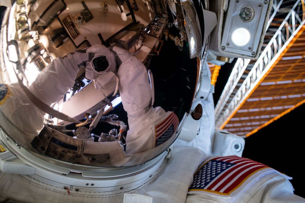 "NASA astronaut Bob Behnken's spacesuit gloves and camera are reflected in his helmet's visor in this ""space-selfie"" taken during a spacewalk on June 26, 2020."