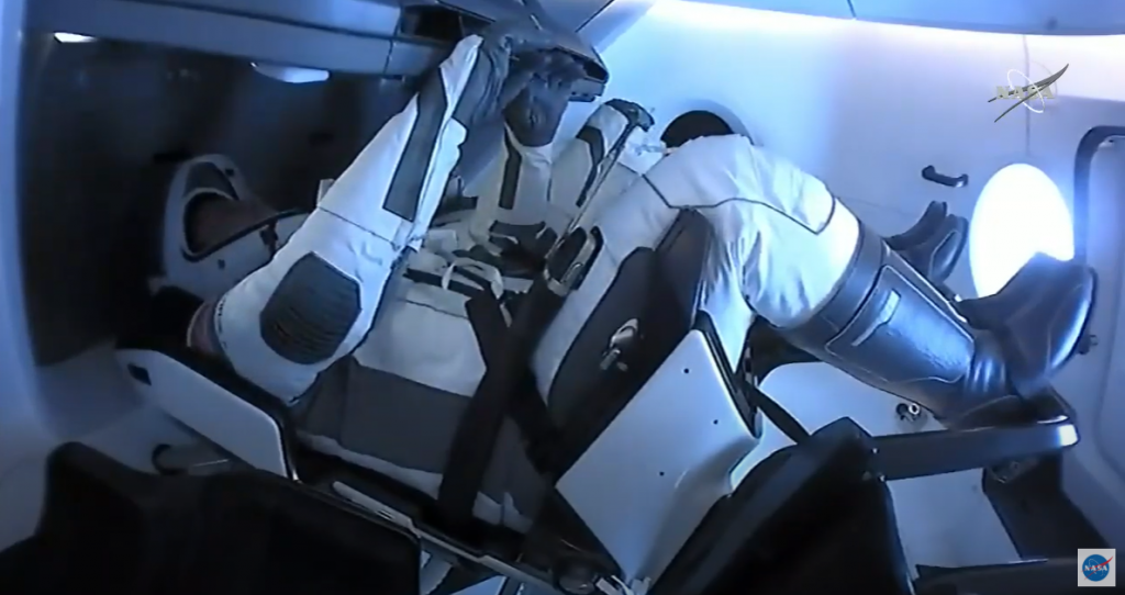 NASA astronauts Robert Behnken and Douglas Hurley are seated inside the SpaceX Crew Dragon spacecraft on Aug. 1, 2020.