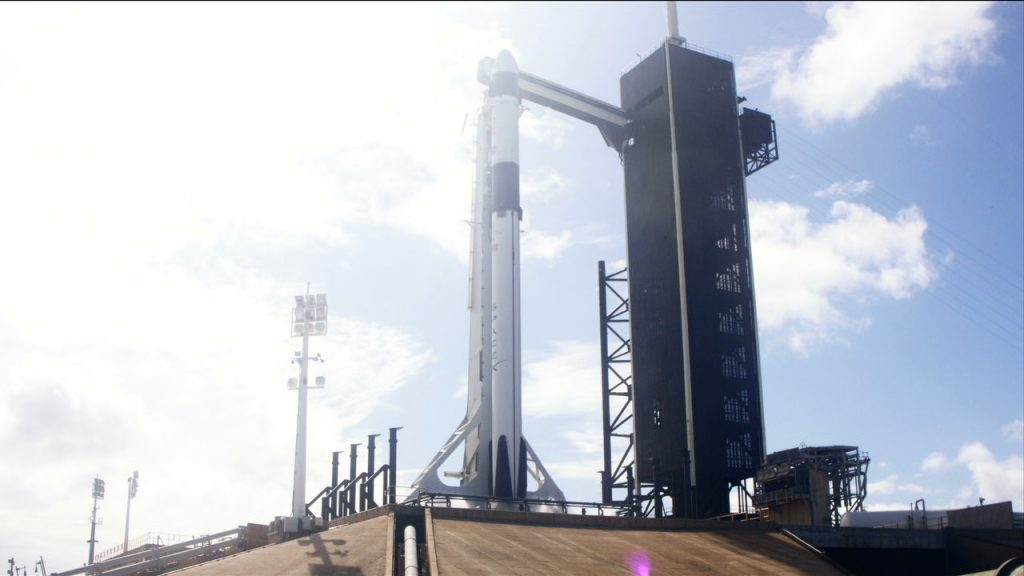 The SpaceX Falcon 9 rocket and Crew Dragon spacecraft stand on the launch pad at Kennedy Space Center's Launch Complex 39A.