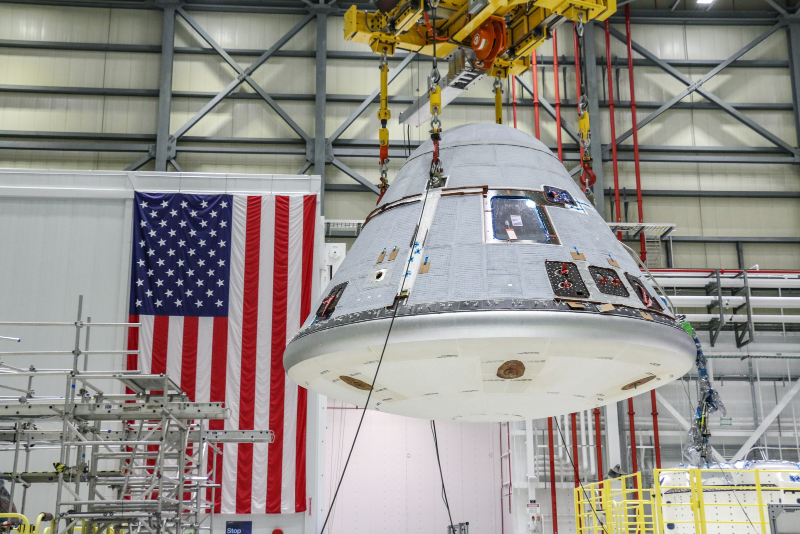 Boeing Starliner is lifted inside processing facility