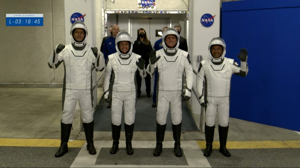 The Crew-2 astronauts walk out the double doors to board their Tesla's for the ride to Launch Complex 39A on April 23, 2021