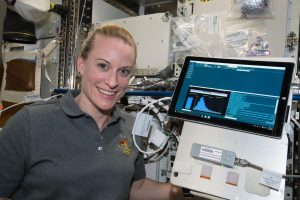 Expedition 64 Flight Engineer Kate Rubins works with Biomolecule Sequencer experiment hardware inside the U.S. laboratory Destiny aboard the International Space Station.