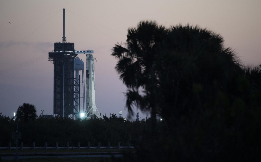 A SpaceX Falcon 9 rocket with the company's Crew Dragon spacecraft onboard is seen at sunrise on the launch pad at Launch Complex 39A as preparations continue for the Crew-2 mission, Thursday, April 22, 2021, at NASA's Kennedy Space Center in Florida.