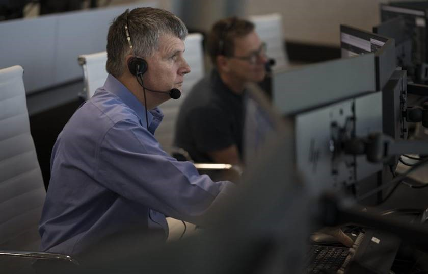 Steve Stich, manager of NASA's Commercial Crew Program, monitors a countdown to launch from Firing Room 4 of the Launch Control Center at NASA's Kennedy Space Center in Florida.