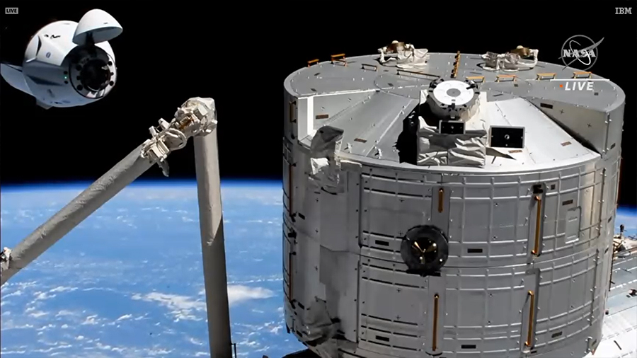 The SpaceX Crew Dragon approaches its space station docking port with the Kibo laboratory module in the foreground. Credit: NASA TV