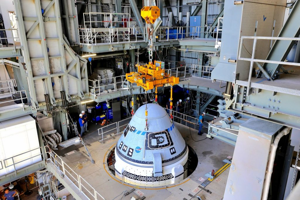 Boeing's CST-100 Starliner spacecraft is secured atop a United Launch Alliance Atlas V rocket at the Vertical Integration Facility at Space Launch Complex-41 at Florida's Cape Canaveral Space Force Station on July 17, 2021. Starliner will launch on the Atlas V for Boeing's second Orbital Flight Test (OFT-2) for NASA's Commercial Crew Program. The spacecraft rolled out from Boeing's Commercial Crew and Cargo Processing Facility at NASA's Kennedy Space Center earlier in the day.