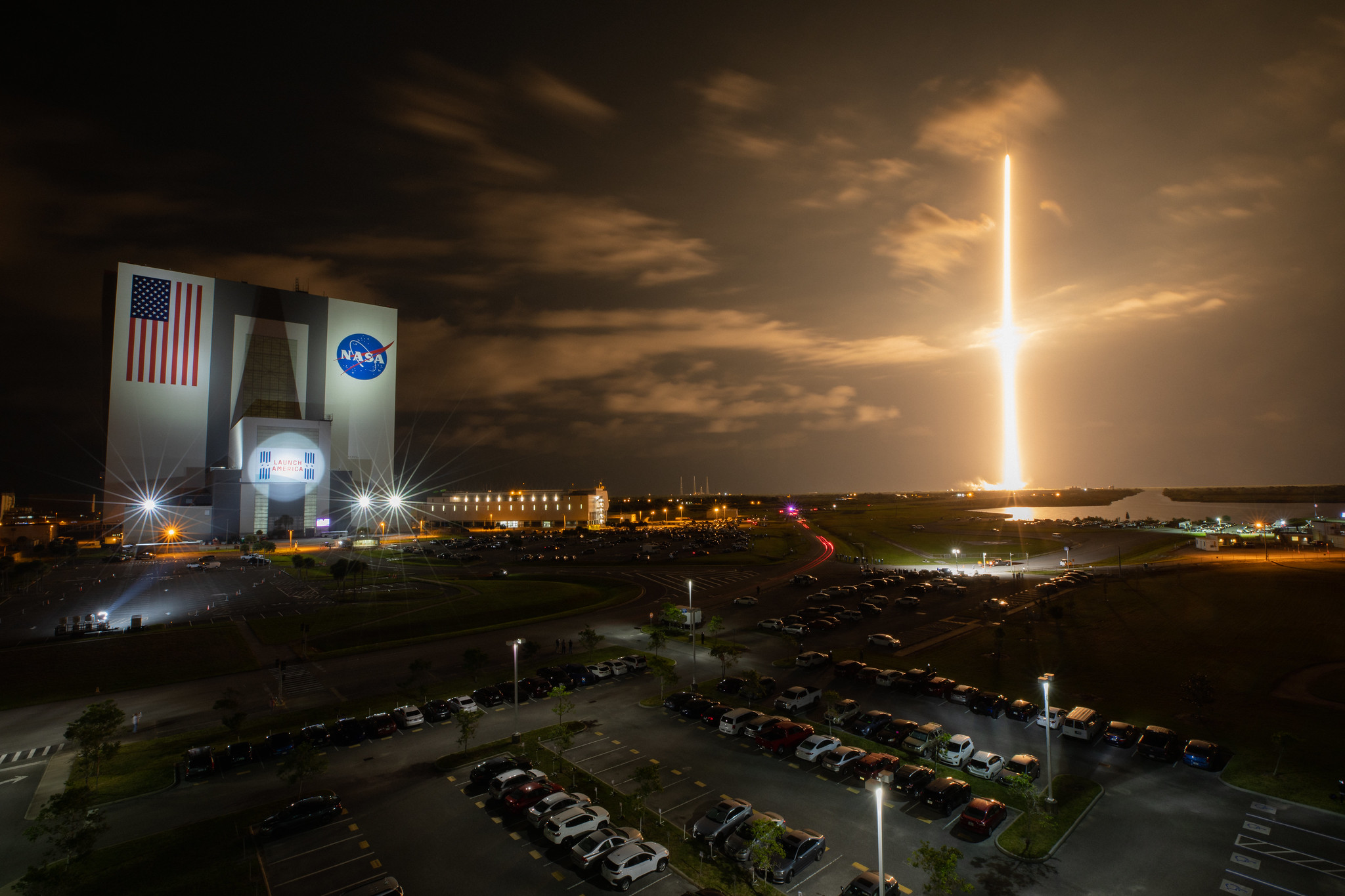 With a view of the iconic Vehicle Assembly Building at left, a SpaceX Falcon 9 rocket soars upward from Launch Complex 39A at NASA's Kennedy Space Center in Florida on April 23, 2021, for NASA's SpaceX Crew-2 mission.