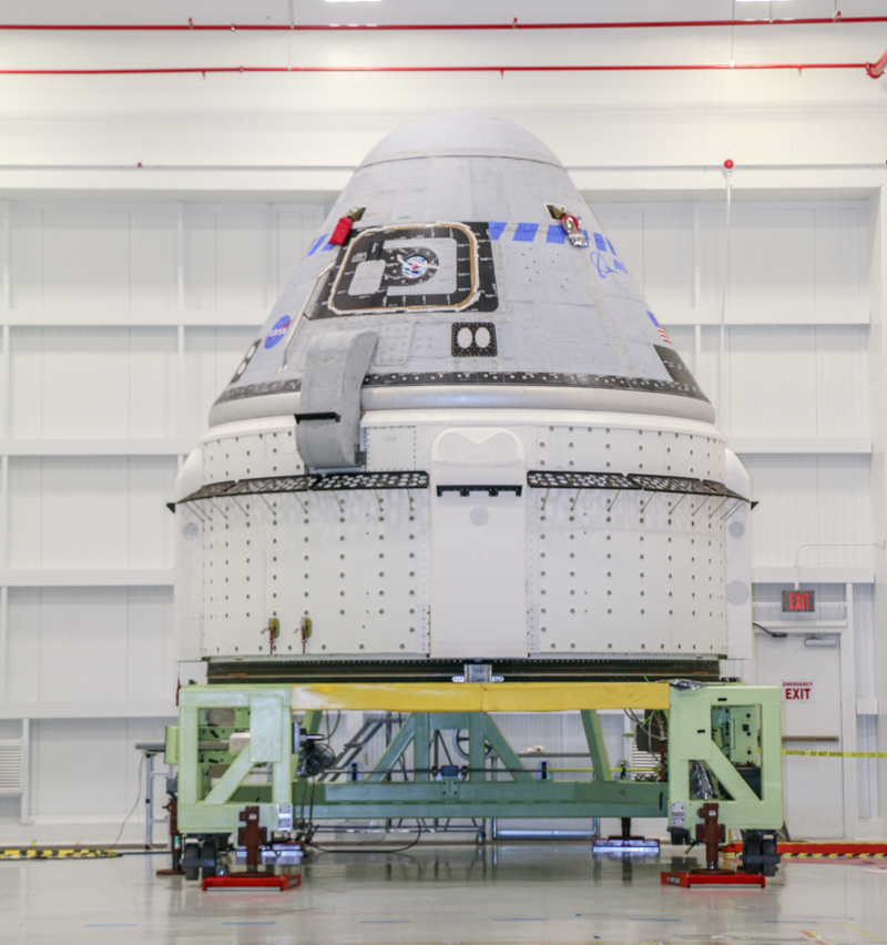 The Boeing CST-100 Starliner spacecraft to be flown on Orbital Flight Test-2 (OFT-2) is seen in the Commercial Crew and Cargo Processing Facility at NASA's Kennedy Space Center in Florida on July 12, 2021.