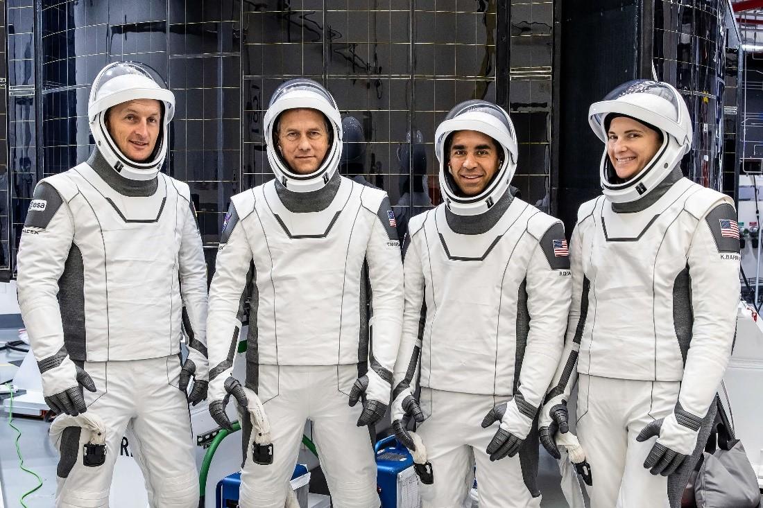 Crew-3 astronauts Matthias Maurer, Thomas Marshburn, Raja Chari, and Kayla Barron pose for a photo in their SpaceX spacesuits.