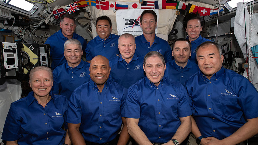 The 11-member crew aboard the station is actually a combination of three different crews. The four Space Crew-2 astronauts are in the back row. The three-person crew of the Soyuz MS-18 crew ship are in the middle row. In the front row is the SpaceX Crew-1 foursome.