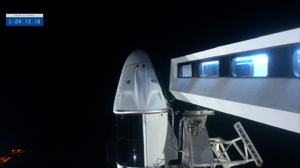 Close-up view of Crew Dragon and the Crew Access Arm.