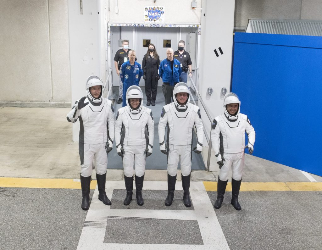 From left to right, ESA (European Space Agency) astronaut Thomas Pesquet, NASA astronauts Megan McArthur and Shane Kimbrough, and Japan Aerospace Exploration Agency (JAXA) astronaut Akihiko Hoshide, wearing SpaceX spacesuits, are seen as they prepare to depart the Neil A. Armstrong Operations and Checkout Building for Launch Complex 39A during a dress rehearsal prior to the Crew-2 mission launch, Sunday, April 18, 2021, at NASA's Kennedy Space Center in Florida. NASA's SpaceX Crew-2 mission is the second operational mission of the SpaceX Crew Dragon spacecraft and Falcon 9 rocket to the International Space Station as part of the agency's Commercial Crew Program. Kimbrough, McArthur, Pesquet, and Hoshide are scheduled to launch at 6:11 a.m. ET on Thursday, April 22, from Launch Complex 39A at the Kennedy Space Center.