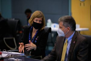 Kathy Lueders, associate administrator, Human Exploration and Operations Mission Directorate, NASA Headquarters, left, talks with Steve Stich, manager, Commercial Crew Program, Kennedy Space Center, during NASA's SpaceX Crew-2 Flight Readiness Review at Kennedy Space Center on April 15, 2021.