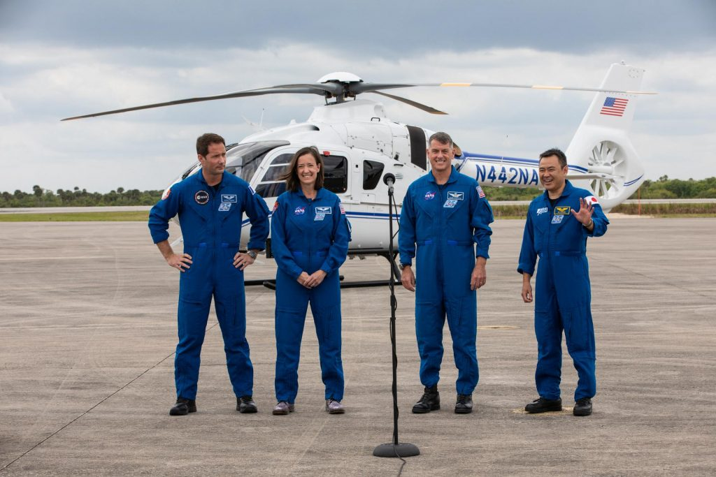 From left to right, Crew-2 mission astronauts Thomas Pesquet (ESA), Megan McArthur (NASA), Shane Kimbrough (NASA) and Ahihiko Hoshide (JAXA), arrive at NASA's Kennedy Space Center on April 16, 2021. The astronauts are set to launch on SpaceX's Falcon 9 rocket and Crew Dragon spacecraft on the second crew rotation mission to the International Space Station as part of NASA's Commercial Crew Program. Liftoff is targeted for 6:11 a.m., on Earth Day, Thursday, April 22, from Launch Complex 39A at Kennedy.